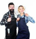 Couple in love hold kitchen utensils. Picnic barbecue. food cooking recipe. Man bearded hipster and girl. Preparation stock photos