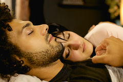 Couple in love holding each other while sleeping at night in bed woman out of focus Royalty Free Stock Photos