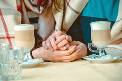 Couple in love holding each others hands Royalty Free Stock Photos