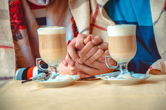 Couple in love holding each others hands Royalty Free Stock Image