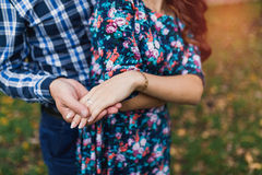 Couple in love holding hands, gently. Stock Photo