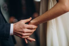 Couple love holding hands man suit woman dress stock image
