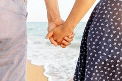 Couple in love holding hands on beach. royalty free stock photo