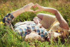 Couple in love holding hands in the shape of heart Royalty Free Stock Images