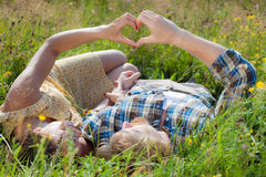 Couple in love holding hands in the shape of heart. Love concept royalty free stock photo