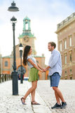 Couple in love holding hands in urban Sweden royalty free stock photos