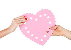 Couple in love holding a heart in their hands Royalty Free Stock Images