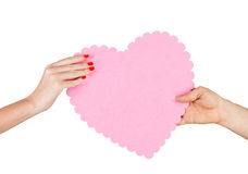 Couple in love holding a red heart in their hands Royalty Free Stock Image