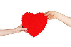 Couple in love holding a red heart in their hands Royalty Free Stock Photo