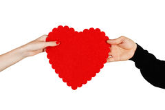 Couple in love holding a red heart in their hands Stock Photos