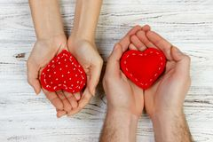 Couple in love holding a red heart in their hands. Valentine day concept.  Stock Images