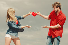 Couple in love holds red heart outdoor Royalty Free Stock Photo
