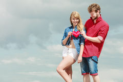 Couple in love holds red heart outdoor Stock Image