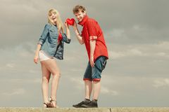 Couple in love holds red heart outdoor stock photography