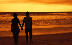 Couple in love on honeymoon at beach. On sunset Stock Photo