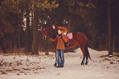 Couple in love with a horse Royalty Free Stock Photos