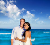 Couple in love hug in blue sea vacation Stock Images