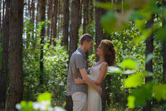 Couple in love hug in forest Royalty Free Stock Photos