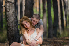 Couple in love hug in forest Stock Photography