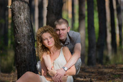 Couple in love hug in forest Stock Images