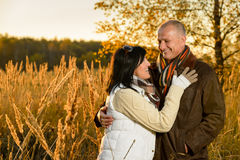 Couple in love hugging in autumn sunset Royalty Free Stock Image