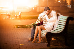 couple in love hugging on bench Royalty Free Stock Photos