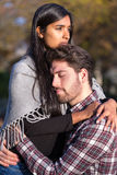Couple in love hugging and kissing outside. Couple in love hugging and kissing outdoors royalty free stock images