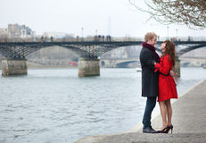 Couple in love hugging near Pont des Arts in Paris. Romantic couple in love hugging near Pont des Arts in Paris Royalty Free Stock Photo
