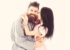 Couple in love hugging in pajama, bathrobe. Couple cuddling, girl kissing macho, isolated on white background. Couple. Family on smiling faces happy in morning stock photos