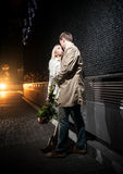 Couple in love hugging on street at night Royalty Free Stock Photo