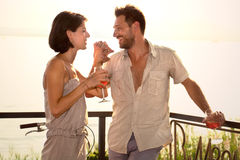 Couple in love jokes at spritztime on the lakeside Royalty Free Stock Photography