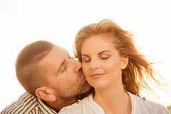 Couple in love - kiss Stock Photo