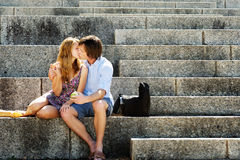 Couple in love kisses on steps of a monument Royalty Free Stock Photography