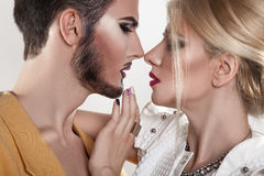 Couple in love kissing. Both with makeup. Passion. Seduction. Royalty Free Stock Photography
