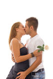 Couple in love kissing in embrace holding rose Stock Photos