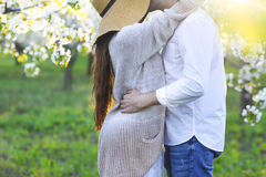 Couple in love kissing and hugging in spring park Stock Photo