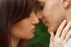 Couple kissing happiness fun. Interracial young couple. Couple in love kissing laughing having fun. Dating interracial young couple embracing on date Stock Photos