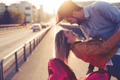 Couple in love kissing laughing and having fun Stock Images