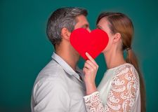 Couple love. Kissing love couple holding heart stock photos