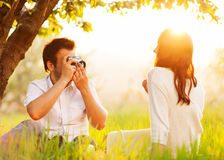 Couple in love kissing in nature stock photo