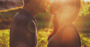Couple in love kissing in summer park Stock Photos