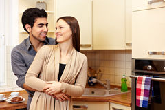 Couple in love in kitchen royalty free stock photography