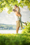 Couple in love on the lake, hug Stock Photos