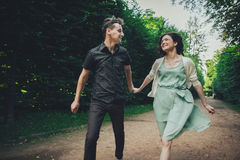 Couple in love laughing looking at each other in the park royalty free stock image