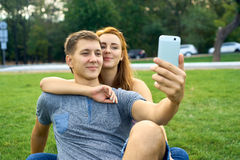 Couple in love on the lawn makes self.  Stock Photos
