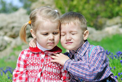 Couple in love little children on green meadow Stock Photos