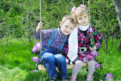 Couple in love little children on green meadow Royalty Free Stock Photos