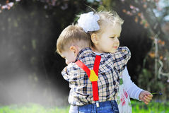 Couple in love little kids for a walk in the park Stock Image