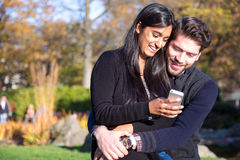 Couple in love looking at cellphone Stock Image
