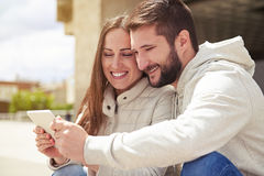 Couple in love looking at tablet pc Royalty Free Stock Photo